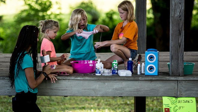 River View graduate, Skyler Stewart Macs helped with the recent talent show at River View Community Park, while Skylar Nelson, Katie Walser, and Amber Nelson made slime.