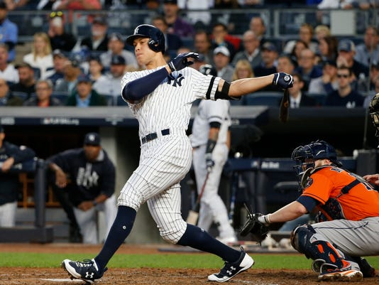 New York Yankees' Aaron Judge hits an RBI double during the third inning of Game 5 of baseball's American League Championship Series against the Houston Astros Wednesday, Oct. 18, 2017, in New York. (AP Photo/Kathy Willens)