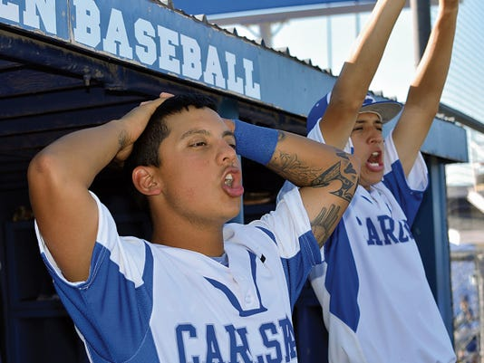 Matt Hollinshead — Current-Argus Cavemen senior second baseman Ryan Garcia (left) reacts to junior third baseman Seth Olguin's two-run double in game one last Friday against Hobbs. The Cavemen will host Sandia in Friday's 2015 U.S. Bank State Baseball Championships opener.