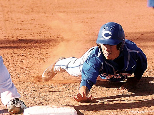Tony Bullocks — Clovis News-Journal Carlsbad junior Seth Olguin gets back safely to first base on a pick-ff attempt in the first game of FridayþÄôs doubleheader at Clovis.