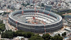 FILE - This July 11, 2018, aerial file photo shows New National Stadium for the Tokyo 2020 Olympics under construction, in Tokyo. The price of the opening and closing ceremony for the Tokyo Olympics has risen about 40 percent according to numbers released by the organizing committee on Friday, Feb. 15, 2019. (Kyodo News via AP, File)