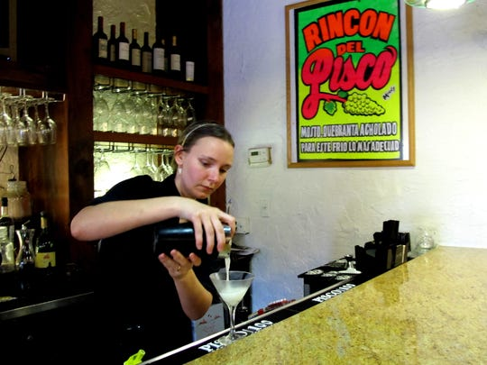 Amanda González-Zúñiga pours a pisco sour at Lima Restaurant and Pisco Bar at Collier Boulevard and Golden Gate Parkway in Golden Gate.