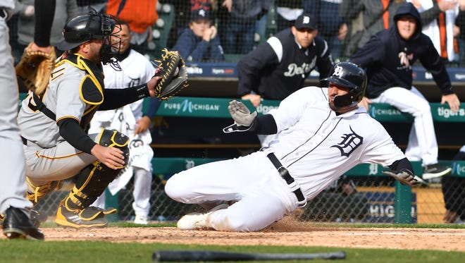 Pirates catcher Francisco Cervelli makes the tag at home plate to get out the Tigers' Nick Castellanos in the 10th inning. Castellanos was called safe but was ruled out on video review.