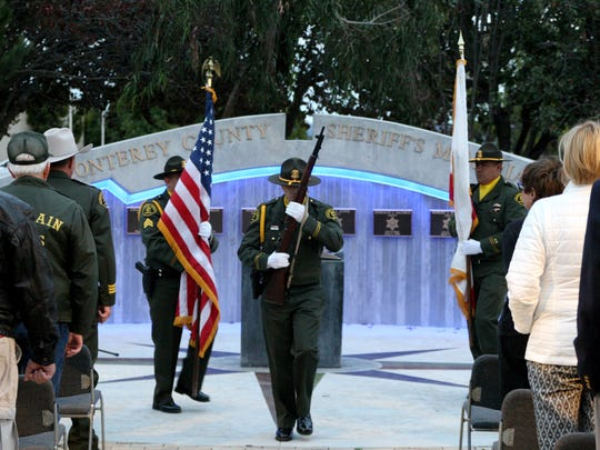 The Monterey County Sheriff's Office honor guard exits remembrance ceremony on Monday evening.