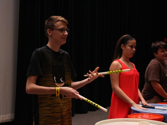 From left: Noah Drumm, Melissa Rodriguez and Peyton Newhart rehearse after school at East Middle School on Oct. 10.