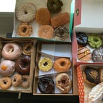 Boxes full of Chicago doughnuts are heavier than one might expect.