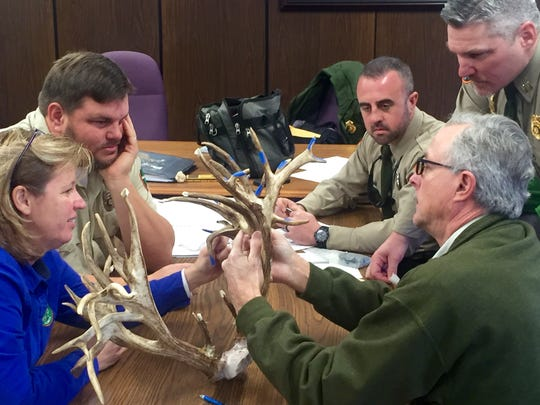 In this 2017 photo, TWRA's Eric Anderson, middle, helped as judges measured antlers from a world record buck shot in Sumner County.
