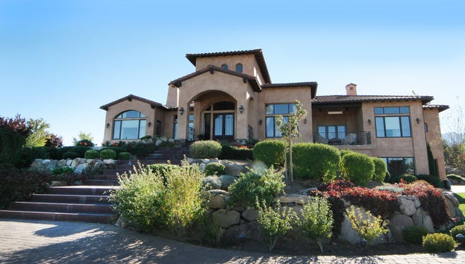 This 2012 photo of a home on Rock Creek Court in Pecetti Ranch overlooks the city and is spacious enough for the homeowners to host parties during the summer and holidays. This year's Home for the Holidays fundraiser for a Reno women's treatment program will be held Dec. 5-7 at Atlantis Casino Resort Spa.