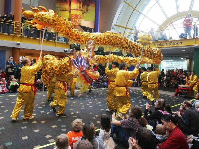 """Saturday, February 1st, 2014, performers from the Indianapolis Chinese Community Center, Inc. perform the traditional """"Dragon Lantern Dance"""". Children and parents gathered at the Indianapolis Children's Museum to celebrate the Chinese New Year with performers from the Indianapolis Chinese Community Center, Inc."""