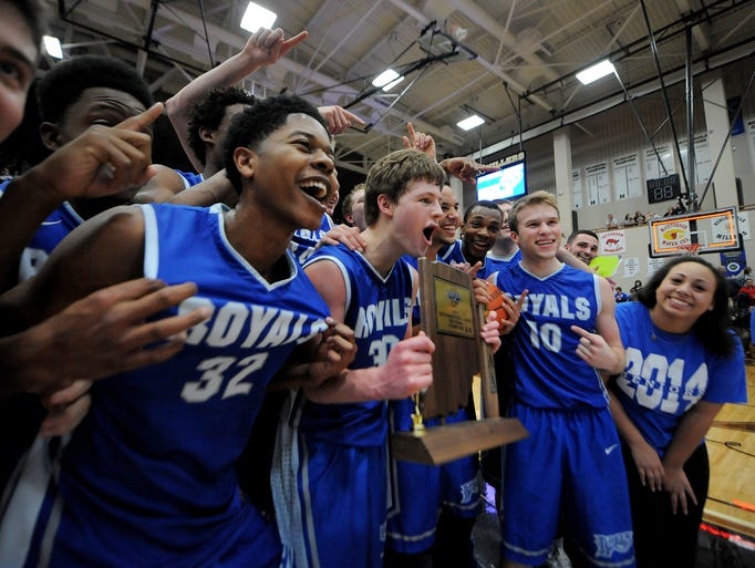 Hamilton Southeastern guard Eric Davidson holds the trophy as the Royals celebrate beating Carmel during the Class 4A Sectional #8 championship game, Saturday, March 8, 2014, at Noblesville High School. HSE won the game 50-42.