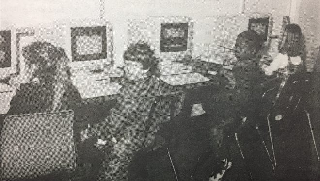 This Uniontown Elementary class found computers a fun but learning experience in January 1996. From left are, Robin French, Kayla Wolfe, Jordan Spaulding, and Kayla Turner.