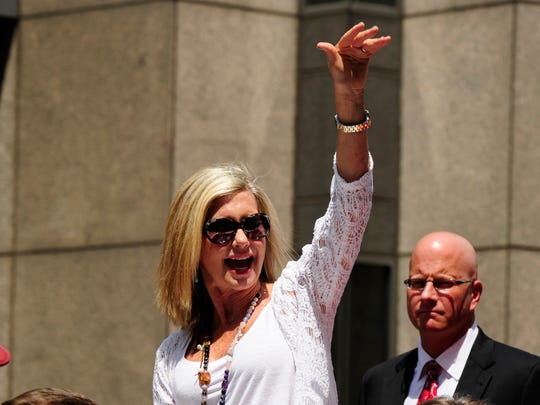 Olivia Newton-John waves to fans during the 2012 Indianapolis 500 Festival Parade.