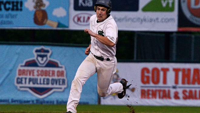 St. Johnsbury's Jake Johnson rounds second base during the Division I high school baseball state championship game on Saturday at Centennial Field.