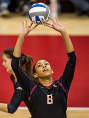 FSU freshman middle blocker Tiana Jackson goes for a set during the Seminoles four set loss to Washington State.