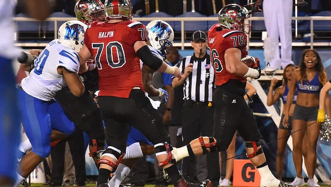 Dec 20, 2016; Boca Raton, FL, USA;  Western Kentucky Hilltoppers offensive lineman Forrest Lamp (76) celebrates after scoring a touchdown against the Memphis Tigers during the first half at FAU Stadium. Mandatory Credit: Jasen Vinlove-USA TODAY Sports