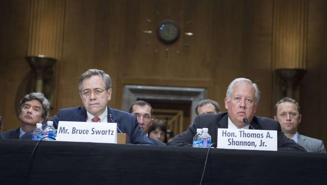 Thomas Shannon, right, counselor of the State Department, tells members of the Senate Foreign Relations Committee that Central American countries need more help to stop children from fleeing to the U.S.