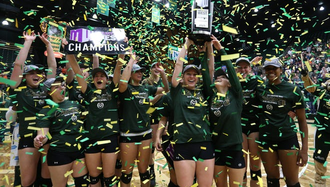 The CSU volleyball team celebrates its seventh straight Mountain West Conference Champion title after defeating Fresno State in three straight sets on Saturday in Moby Arena.