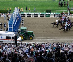 FILE - In this Saturday, June 9, 2018, file photo, race horses break out of the starting gate during the 150th running of the Belmont Stakes horse race, in Elmont, N.Y. Justify won to win the Triple Crown. The home of the Belmont is laps ahead of other racetracks around the country when it comes to safety measures to keep horses and jockeys safe. (AP Photo/Mel Evans, File)