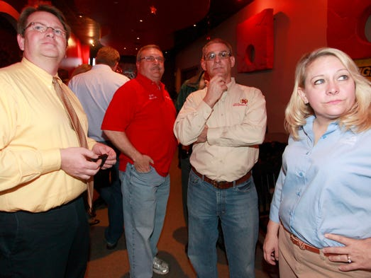 Springfield city officials look at election results during a watch party at Parlor 88 on Tuesday, April 8, 2014.