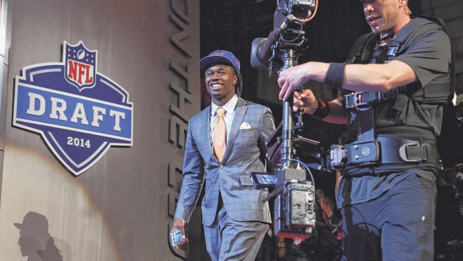 Sammy Watkins, a Fort Myers native, walks to the stage after being selected as the No. 4 overall pick by the Buffalo Bills on Thursday night.Adam Hunger/USA Today Sports