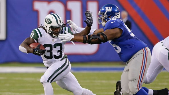 New York Jets running back Chris Ivory struggles against