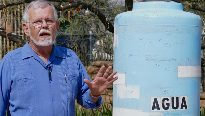 Robin Hoover with one of the original water tanks used by Humane Borders in southern Arizona to prevent migrant deaths.