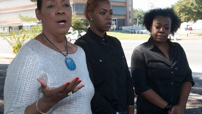 Thelma Roby, the grandmother of a West Florida High School student facing expulsion talks, with local civil rights leaders and the media during press conference to discuss the issue Thursday morning.