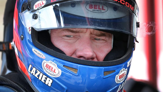 Buddy Lazier gets ready to get in his car during practice for the Indianapolis 500, May 14, 2015 at the Indianapolis Motor Speedway.