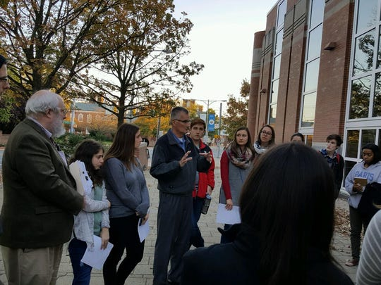 University of Delaware students gather outside the Trabant University Center for a commemoration honoring fallen college student Matthew Rosin on Sunday, Oct. 23, 2016