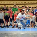 Bill Zadick leads campers through warm-up drills at the beginning of the Zadick Brothers Wrestling Camp two years ago at the old GFH gymnasium. This year's camp will be at the University of Great Falls in mid-June.