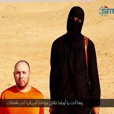 This screen grab from a video posted by a the Islamic State terrorist group purportedly shows American freelance journalist Steven Sotloff, 31, moments bef