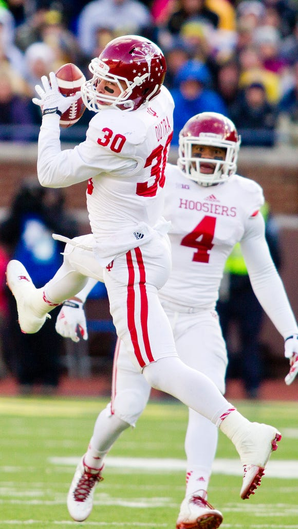 Indiana safety Chase Dutra (30) makes an interception with linebacker Forisse Hardin (4) watching in the second quarter of an NCAA college football game against Michigan in Ann Arbor, Mich., Saturday, Nov. 1, 2014. (AP Photo/Tony Ding)