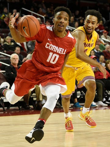 Cornell guard Matt Morgan, left, drives the ball past Southern California guard Jordan McLaughlin during the first half of an NCAA college basketball game in Los Angeles, Monday, Dec. 19, 2016. (AP Photo/Kelvin Kuo)