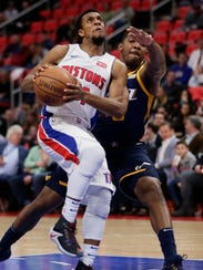 Pistons guard Ish Smith (14) is guarded by Jazz guard