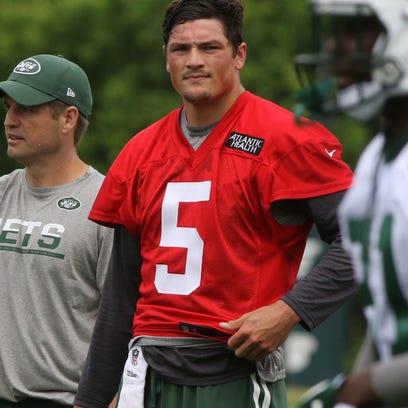 Quarterback coach Jeremy Bates and quarterback Christian