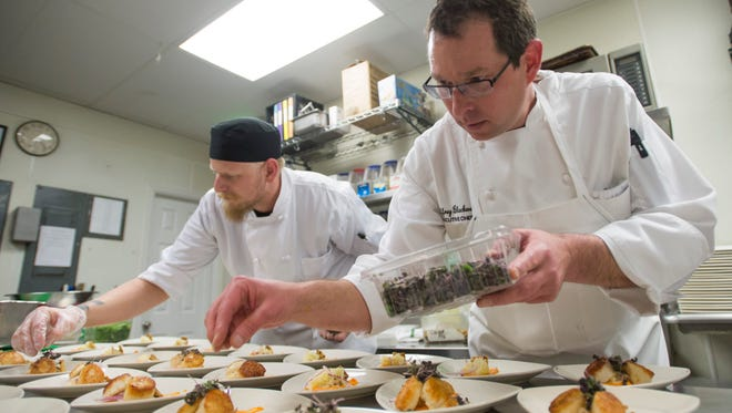 Executive chef Jeffrey Blackwell and AJ Roberts plate dishes during dinner service at Moot House Wednesday, March 9, 2016.
