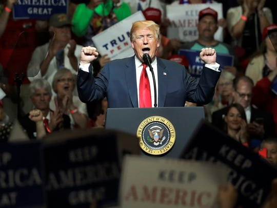 President Donald Trump addresses the crowd during a Republican campaign rally Thursday, May 10, 2018, in Elkhart, Ind. (AP Photo/Charles Rex Arbogast)