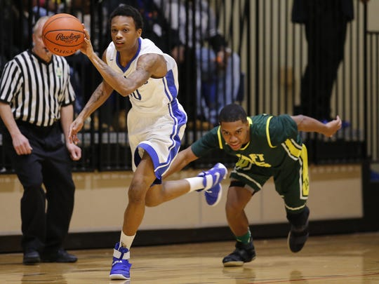 Woodward guard Dionte McBride (30) starts a fast break after stealing the ball.