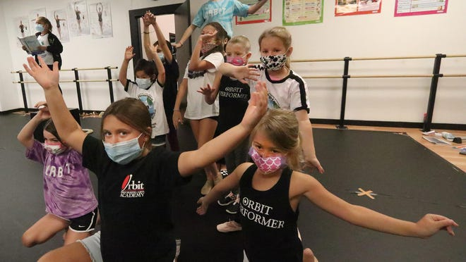 "Youngsters at Orbit Performing Arts Academy rehearse ""Moana Junior"" Tuesday July 21, 2020 in the Port Orange dance studio. Nearly 100 dancers at Orbit are part of a virtual dance recital, which will be shown on the big screen at Daytona Beach Drive-In Christian Church this Friday."