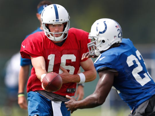 Indianapolis Colts quarterback Scott Tolzien (16) hands the ball off to running back Frank Gore (23) during their preseason practice at the Colts complex on west 56th Street Tuesday, Aug. 29, 2017.
