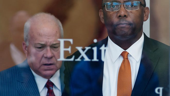 Former Mississippi Corrections Commissioner Chris Epps, right, leaves at the U.S. Courthouse in Jackson on Thursday Nov. 6 with his attorney, John Colette, following Epps arraignment on multiple charges, including bribery, money laundering and wire fraud.