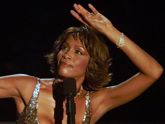 """New Jersey native Whitney Houston strikes a pose during her performance at the Shrine Auditorium in Los Angeles in this April 10, 2000 file photo, during taping of the """"25 Years of #1 Hits: Arista Records' Anniversary Celebration."""""""