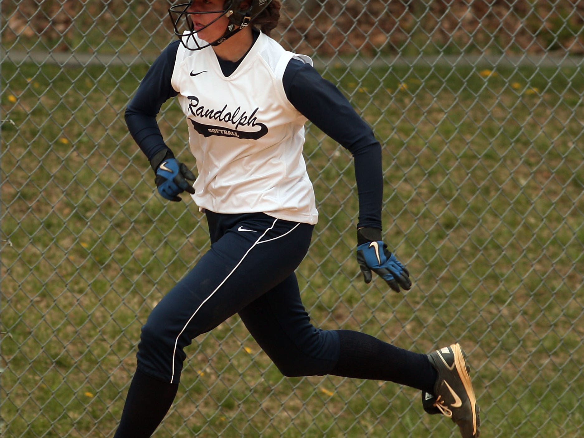 Randolph's Cynthia Meringer rounds third after hitting a home run.