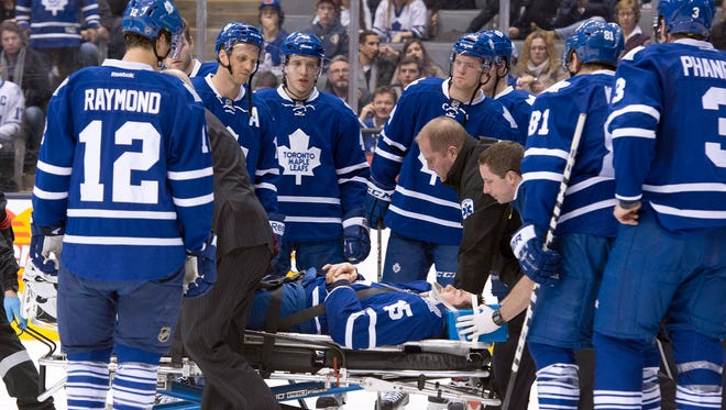 Toronto Maple Leafs' Paul Ranger is taken off the ice on a stretcher after hitting the boards head first from a check by Tampa Bay Lightning's Alex Killorn.
