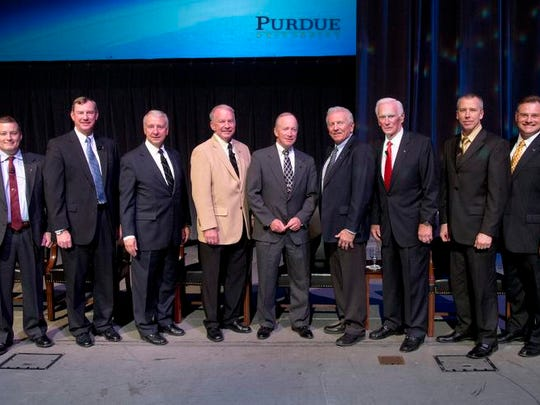 Seven Purdue astronauts gather for a group shot with Purdue President Mitch Daniels (center) after a forum Saturday at Elliott Hall of Music. They are Scott Tingle, left, Mark Brown, Charles Walker, Gary Payton, Loren Shriver and Gene Cernan. On the right is Kirk Cerny, Purdue Alumni Association president.