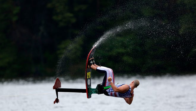 Water flies into the air as a U.S.A. skiier performs during the World Water Skiing Show in Wisconsin Rapids, Wisconsin, September 10, 2016.