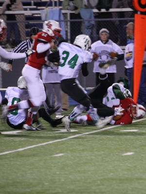 La Salle junior running back Jeremy Larkin carries for a first down in the first quarter against Harrison on Friday night.