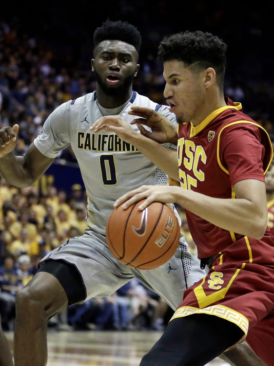 Southern California's Bennie Boatwright, right, drives the ball against California's Jaylen Brown (0) in the first half of an NCAA college basketball game Sunday, Feb. 28, 2016, in Berkeley, Calif. (AP Photo/Ben Margot)
