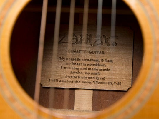 Michal Chabo's father risked his life to retrieve this guitar his son left behind in Aleppo, Syria. Inside it is the inscription for Psalm 57, verses 7-8.