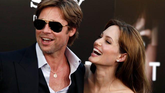 "Angelina Jolie and Brad Pitt arrive at the premiere of ""Salt"" in Los Angeles on July 19, 2010. Jolie and Pitt were married Saturday, Aug. 23, 2014, in France, according to a spokesman for the couple."